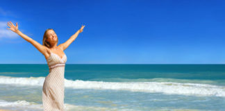 Happy woman in the beach