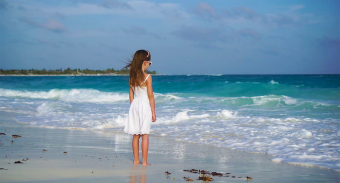 Girl standing on the sand