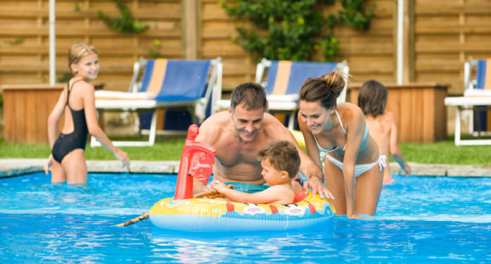 Family of four in a pool