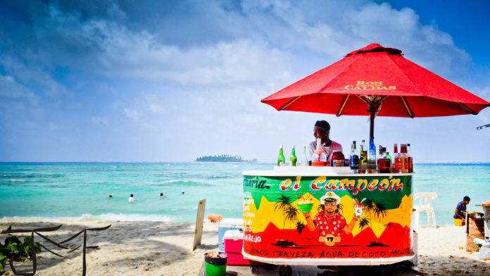 Man selling drink on the beach
