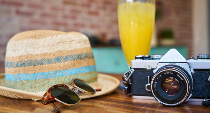 Camera, glasses and a hat